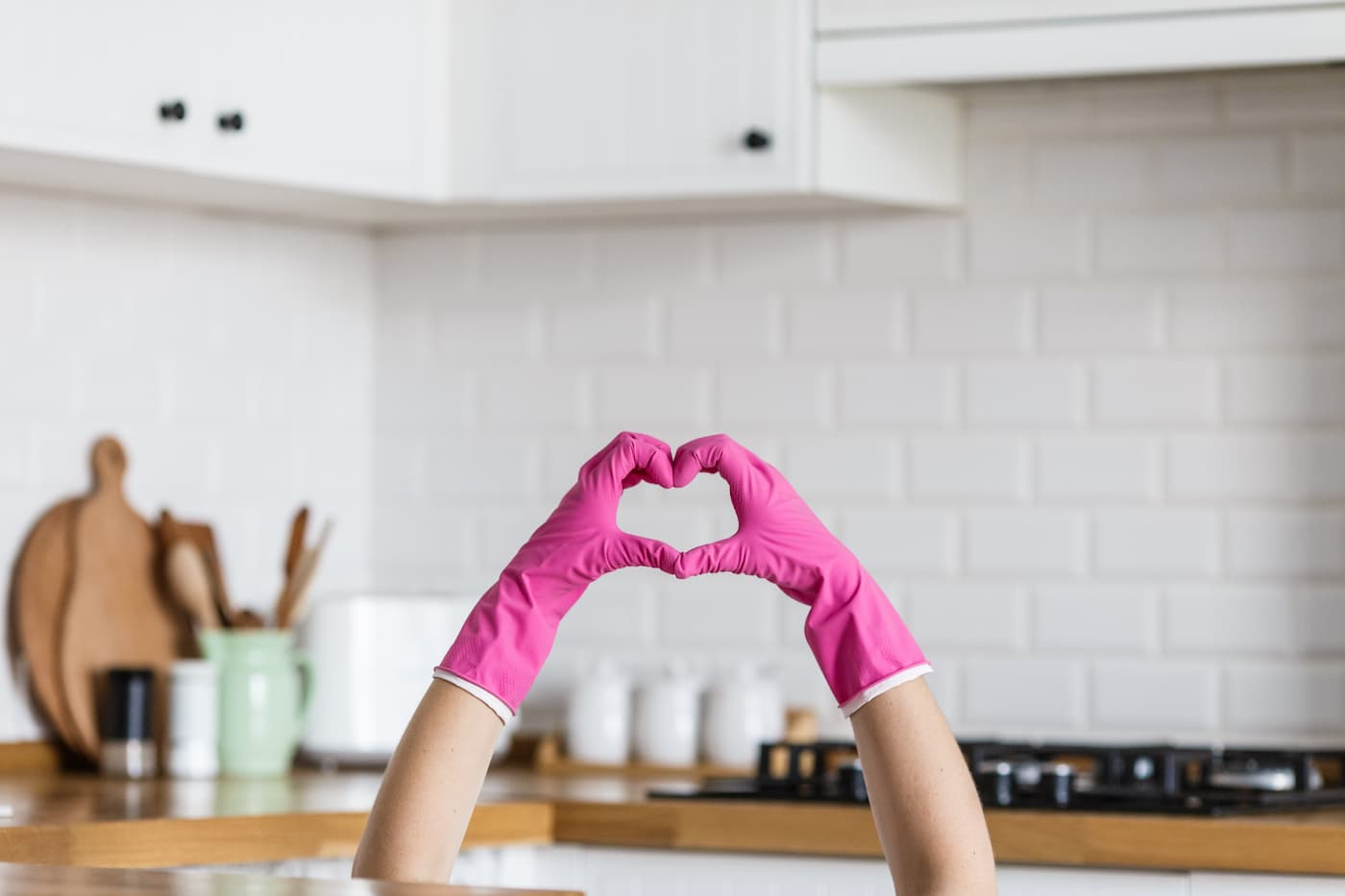 hand with rubber gloves making a heart shape