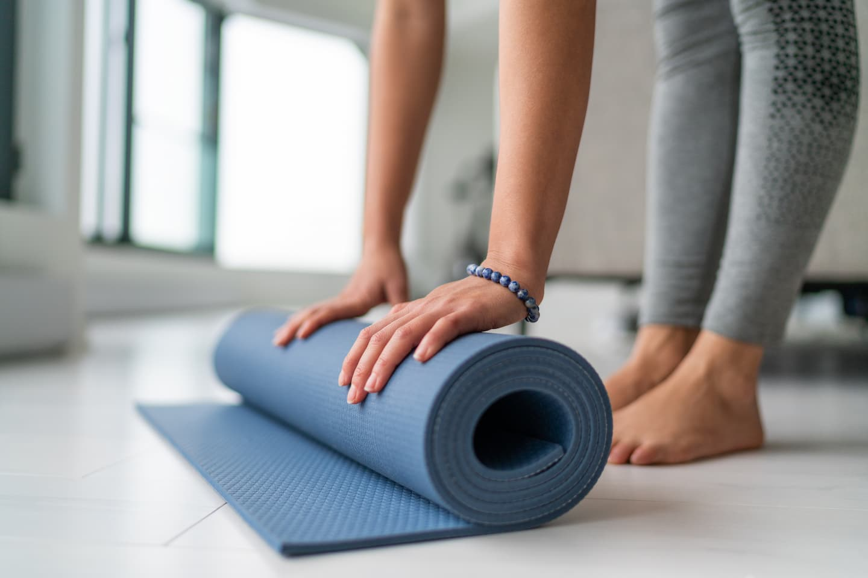 rolling up a yoga mat