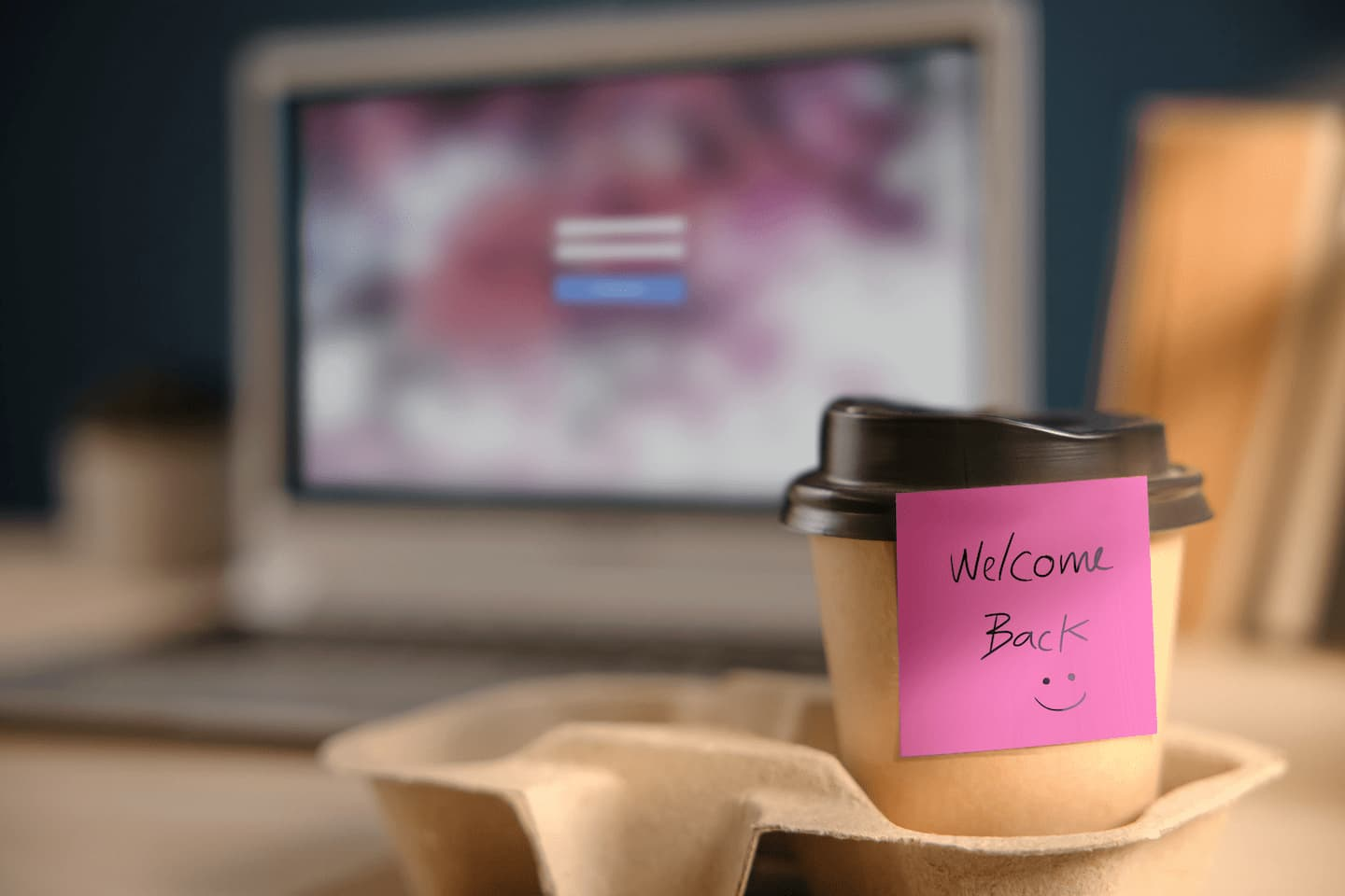 coffee cup with sticky note saying welcome back